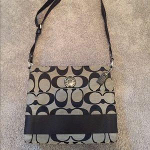 Coach signature shoulder bag.
